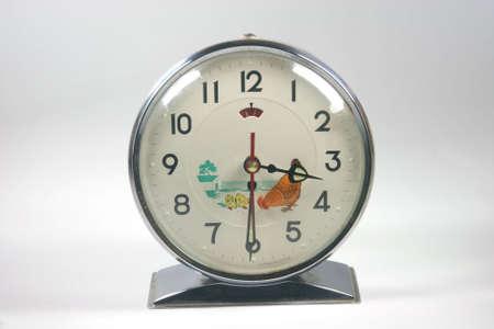 oldies: retro alarm clock closeup in white background