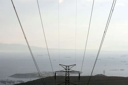 prespective: prespective dark electric cables and view of sea and ships in the afternoon at piraeus greece