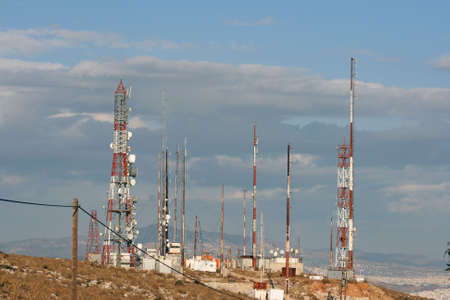 communication antenas above the city in a cloudy day athens greece photo
