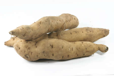 agriculture sweet potatoes closeup isolated in white Foto de archivo