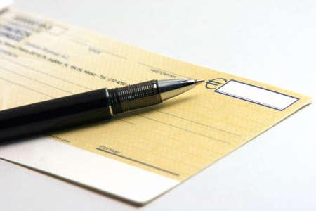 ballpen: business deal money check writing with ballpen in white background