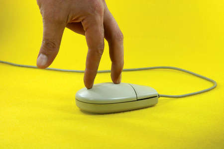 surfing on mouse in yellow background