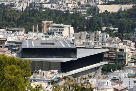 the new museum of acropolis in background can see the pillars of sports competition zeus and kalimarmaro stadium landmarks of athens greece