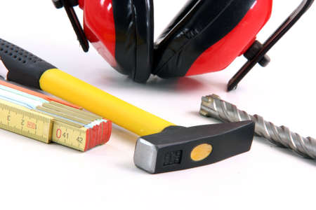 cautions: hardware tools meter hamer drill and ear protection detail in white background
