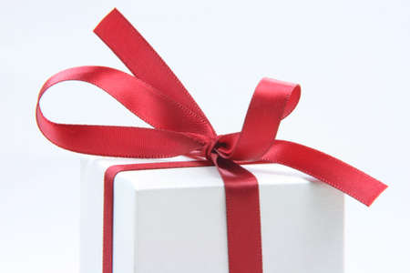 closeup gift box with red ribbon  isolated on white background