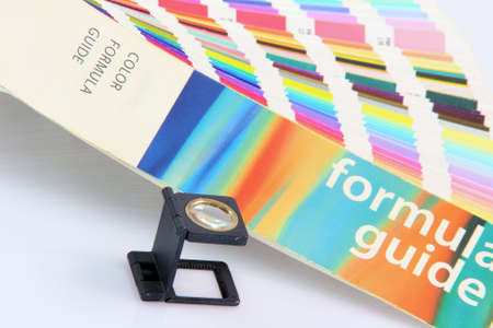 detail pantone colors formula guide with graphic art loupe lense isolated on white background