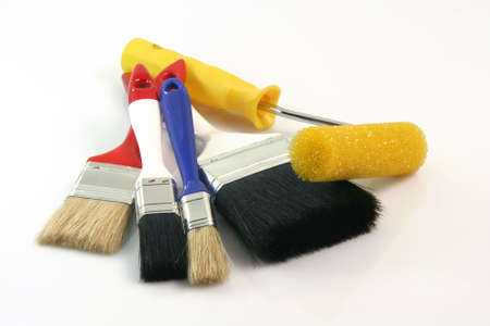 four paint brushes and paint roll on white background hardware tools photo