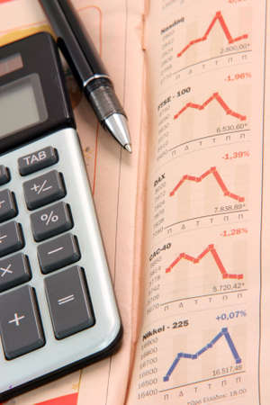 ball pen: finance business concepts stock exchange charts on newspaper with black ball pen and calculator Stock Photo