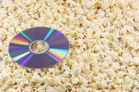 junkfood: dvd disc movie on pop corn background food and entertainment conceps