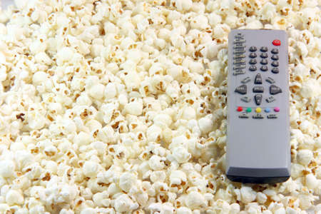 television remote control  on pop corn background food and entertainment conceps Stock Photo - 2303123