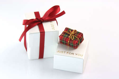 just for you gift box wrapped with red ribbon and a tiny gift box valentines day concepts photo