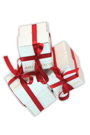 three white gift boxes with red ribbon for valentines day and love gifts with clipping path photo