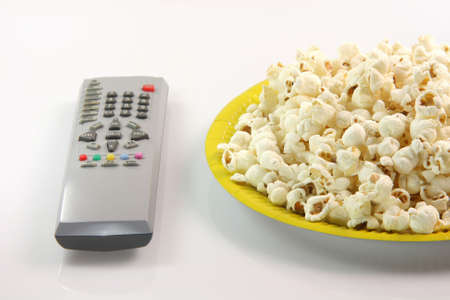 yellow paper plate with pop corn and television remote control food and entertainment conceps Stock Photo - 2303096