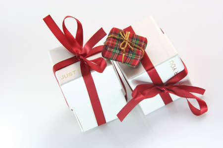 one small tiny gift box with two white gift boxes with red ribbon for valentines day and love gifts shopping concepts photo