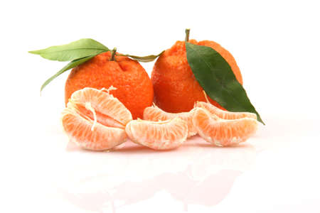 two mandarins with leaf and slices isolated on white background fruits and agriculture concepts Stock Photo