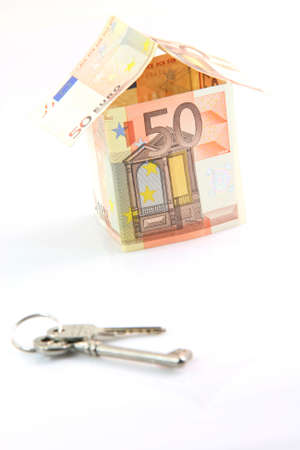 finance banking constuction and business concepts house with euro money and keys blur in front isolated on white background Foto de archivo