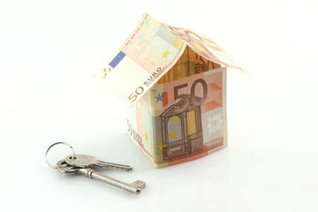 finance banking constuction and business concepts house with euro money and keys isolated on white background