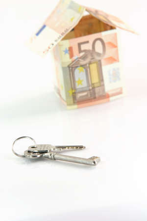 finance banking constuction and business concepts blur house with euro money and focus on keys isolated on white background