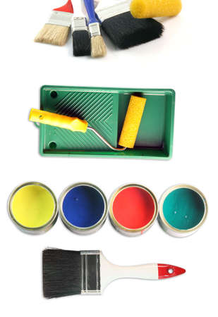 four color cans with paint brushes and paint roll totaly isolated on white background hardware tools photo