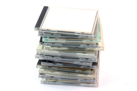 pile of cd cases isolated on white background and empty label to add your message Foto de archivo