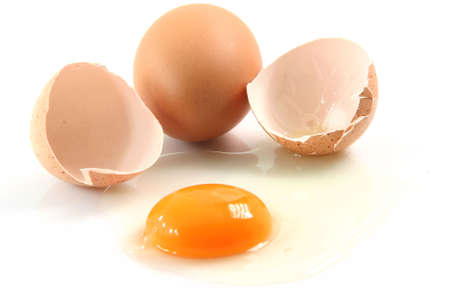two eggs one is broken food concepts isolated on white background Stock Photo