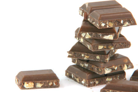 closeup chocolate pieces on stack with copy space isolated on white background food and sweets concepts