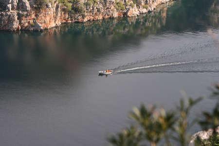 sailling: small boat sailling in calm sea natural beauty Stock Photo