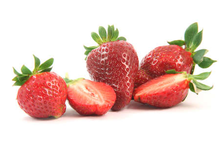 group of strawberries close-up one is cut in half isolated on white background healthy eating