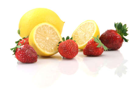 lemons and strawberries isolated on white background with reflection healthy eating