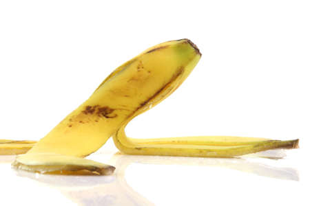 deatil from peel of banana with reflection isolated on white background dangerous cocepts photo
