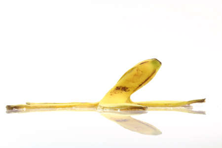 peel of banana with reflection isolated on white background dangerous cocepts photo