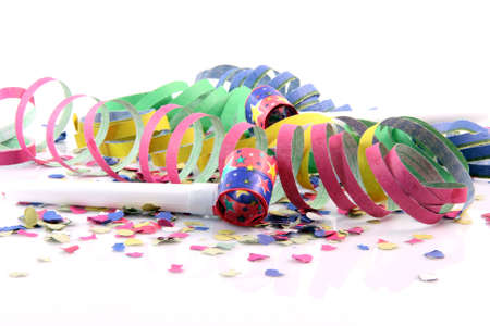 blowers: holidays and party time paper confetti with streamers and party blowers on white background