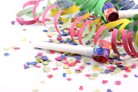 paper confetti with streamers and party blowers on white background with copy space Foto de archivo