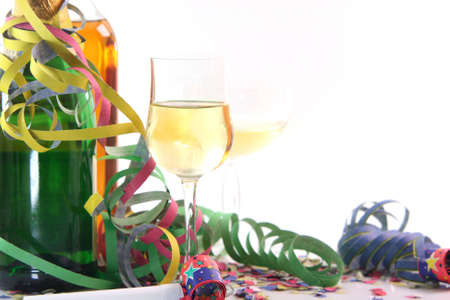 party time with copy space glasses spirits and paper confetti with streamers and party blowers on white background photo