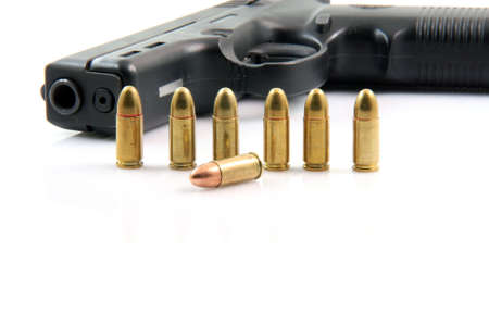 seven bullets and handgun closeup isolated on white background