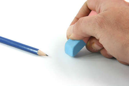 business concepts closeup  erasing mistakes and black pencil isolated on white background
