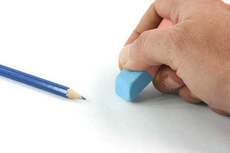 rectify: Concetti commerciali closeup cancellazione errori e matita nera su sfondo bianco isolato  Archivio Fotografico