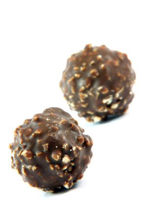 two ball chocolate cookies  focus on front blur back isolated food and sweets concepts Foto de archivo