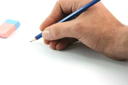 writting with black pencil closeup and eraser isolated on white background business concepts Foto de archivo