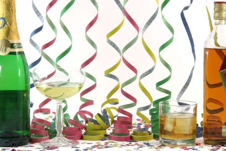 alchohol whiskey champagne streamers confetti celebration and holidays concepts horizontal