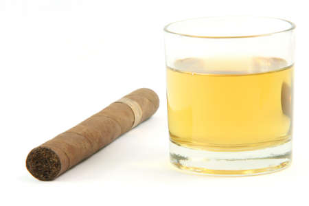 cigar and  whiskey glass isolated on white background