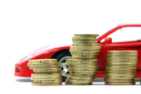 coins and sports red car blur in background isolated business and finance