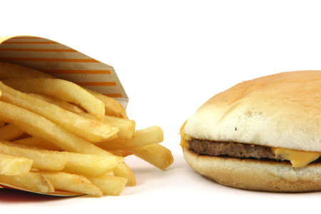 french fries and cheeseburger  detail on white backround food concepts photo