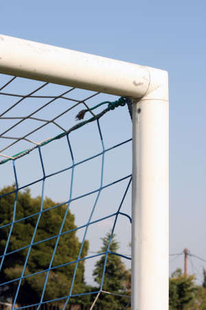 goalpost: detail from soccer goalpost and blue sky background sports concepts