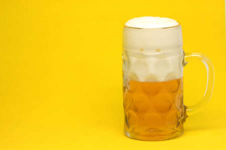 classic bavarian beer mug in yellow background with copy space photo