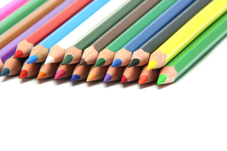 multy: stack of multy color pencils sharpened isolated on white backgroud with copy space closeup