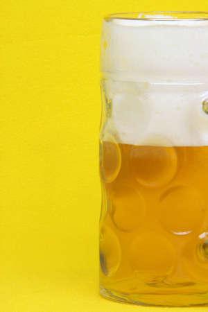 bavarian beer mug detail in yellow background photo