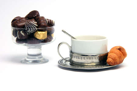 chocolate teacup and croisant isolated on white background photo