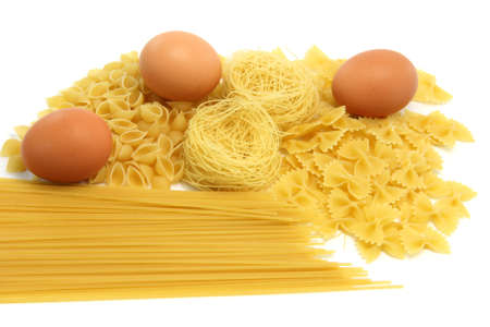 spaghetti assortment and eggs isolated on white background  photo