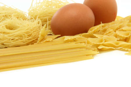 spaghetti assortment and eggs isolated on white background with copy space food concepts photo